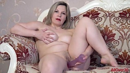 Rose plays her pussy with a silicone partner